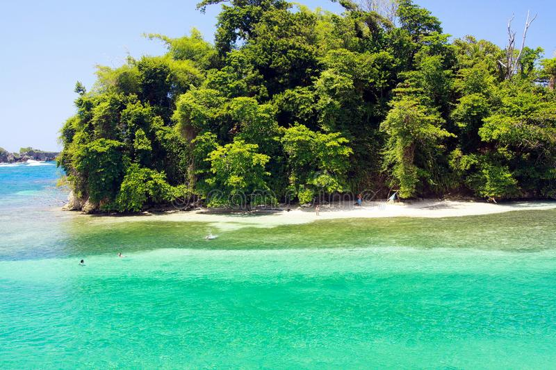 View on secluded islet with white sand and turquoise water - Blue lagoon in Portland, Jamaica stock image