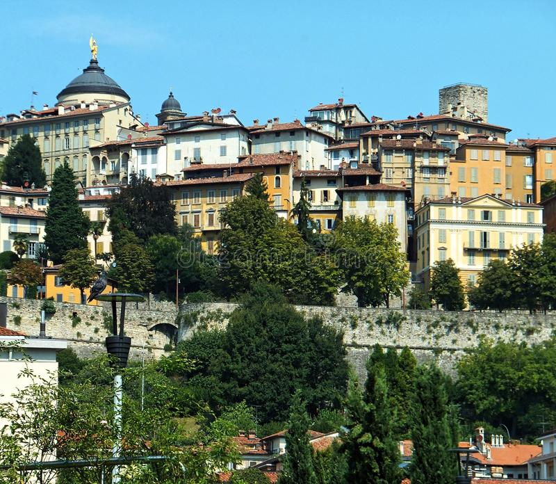View of a section of Bergamo's historical Citta Alta Upper Town against blue sky stock image