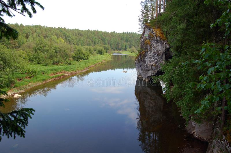 View of a quiet Ural river with a rocky shore stock image