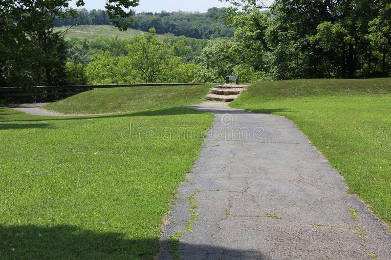 View of the serpent mound at the ground level. This Mound was built by the Fort Ancient culture around 1070 CE. Serpent Mound is the largest serpent effigy in royalty free stock photos