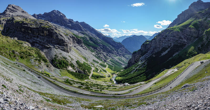 View of serpentine road of Stelvio Pass, Bormio side. Top view of serpentine road of Stelvio Pass from above. Bormio side with cars and motorbikes royalty free stock image