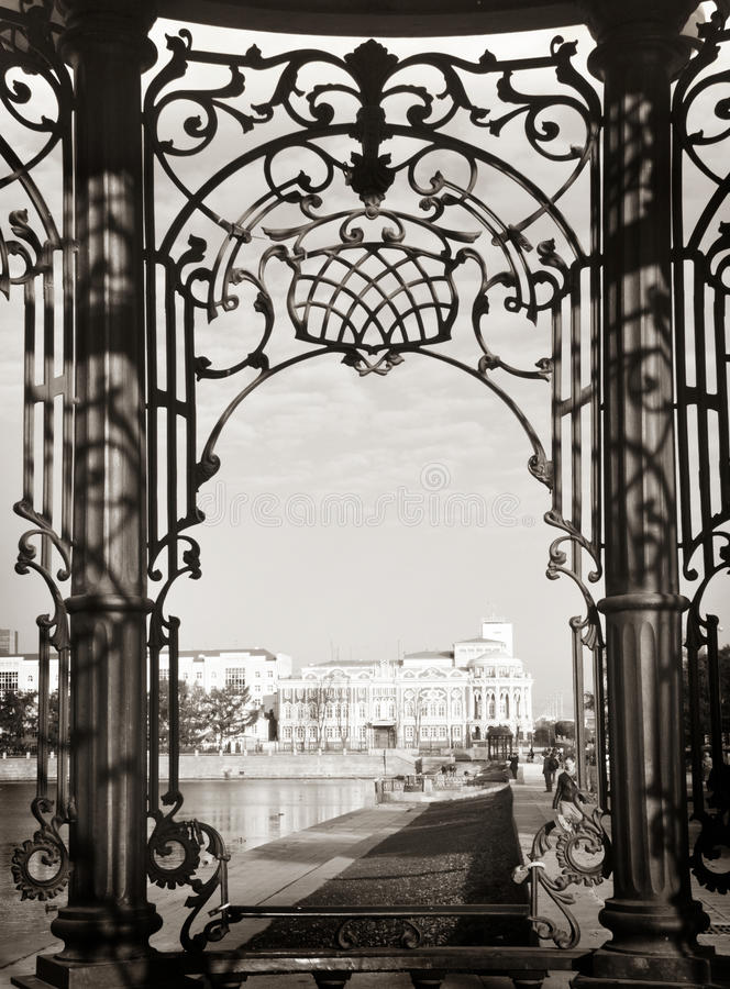 View of the Sevastianov's mansion through beautiful carved wrought iron bars, Ekaterinburg royalty free stock images