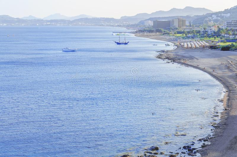 View of several hotel resort beach from high point with blue sea. Background stock images