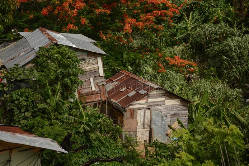 A Couple Tropical Fixer Uppers. A view of shack like dwellings in the valley near Los Guandules, Dominican Republic stock photos