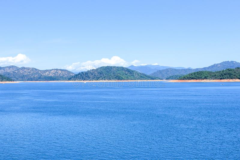 View of the Shasta Lake, California, USA. Shasta Dam also known as Kennett Dam is a concrete arch-gravity dam across the Sacramento Riverin  royalty free stock photography