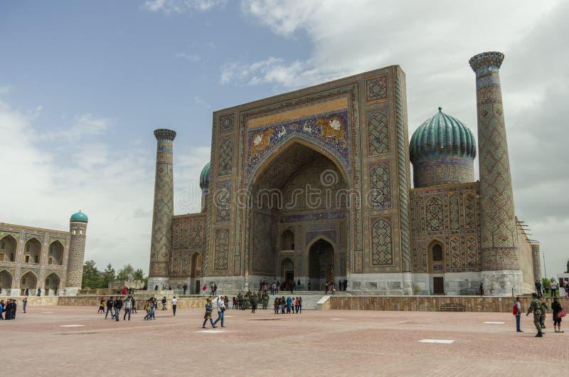 View of Sher-Dor Madrasa from Registan Square, Samarkand, Uzbekistan. royalty free stock photography
