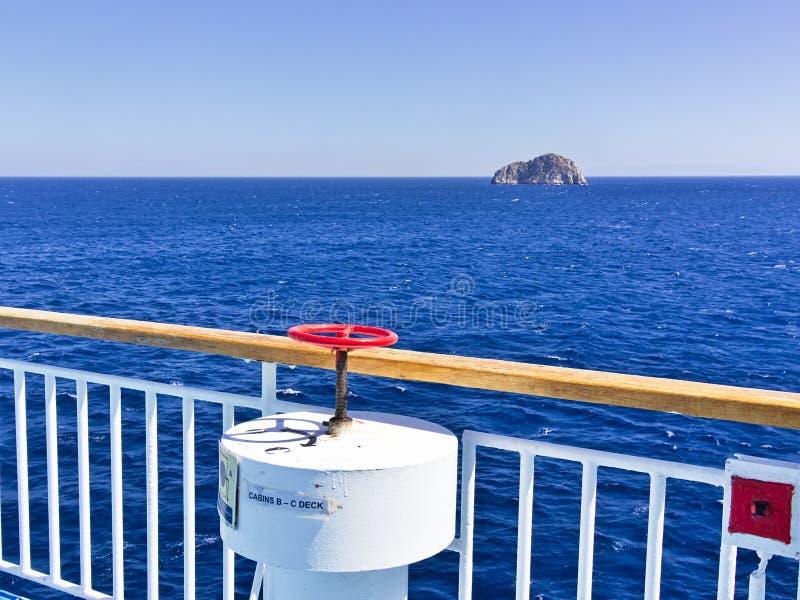 "View from ship deck to Aegean sea and desert rock island, named ""Venetiko"" near Chios island, Greece stock photos"