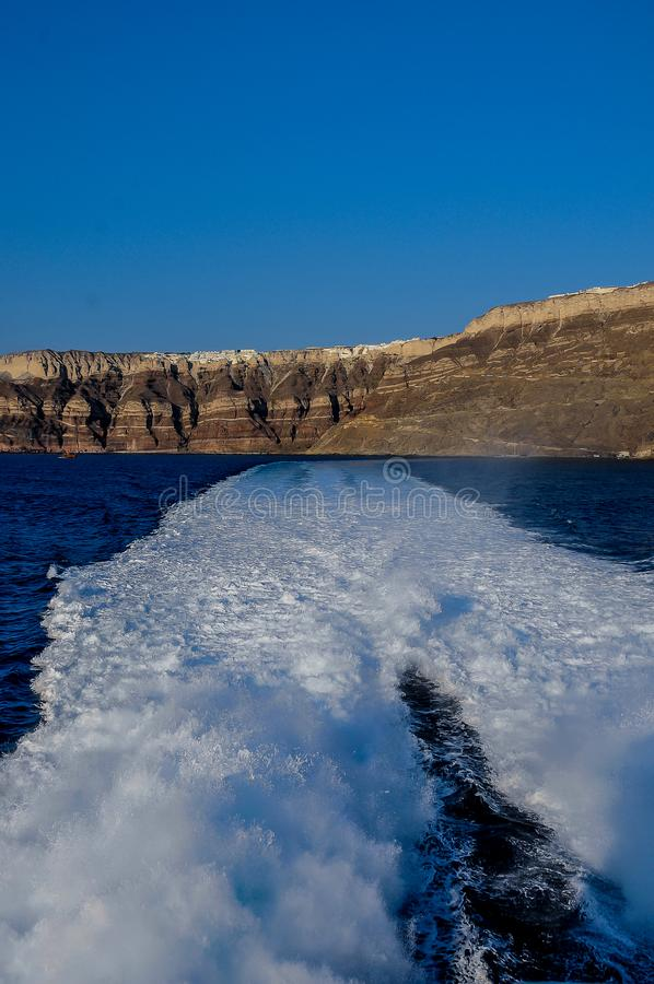 View from the ship to the sea and Santorini Island stock image