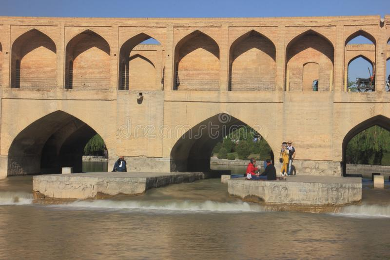 The view of Si-o-se-pol Bridge in Isfahan, Iran with people. royalty free stock photography