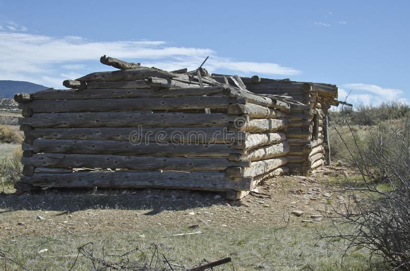 The side of the old broken log cabin stock photos
