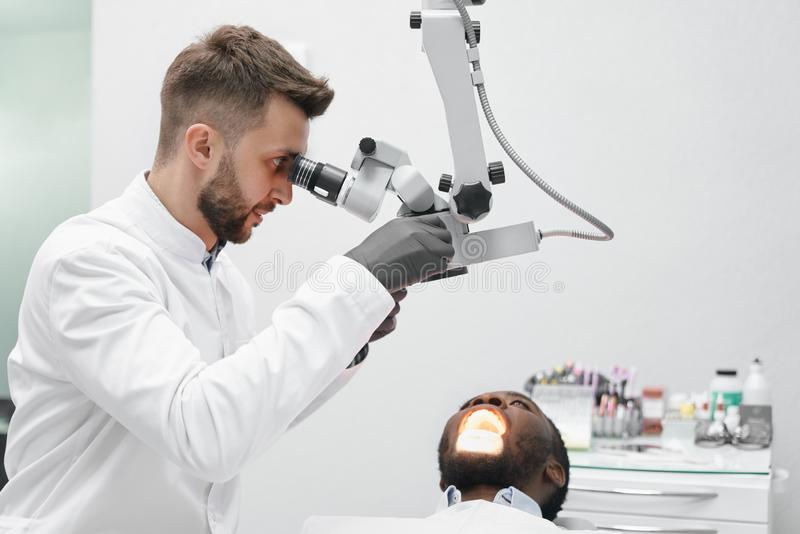 View from side of professional dentist working in clinic royalty free stock photo