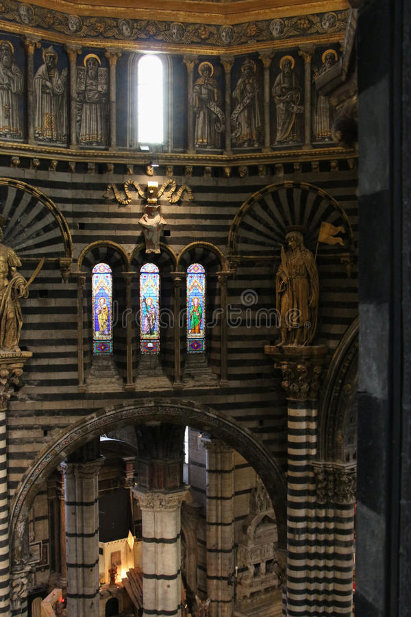 View of the Siena Cathedral interior from the passageway under the roof. Tuscany, Italy. royalty free stock photo