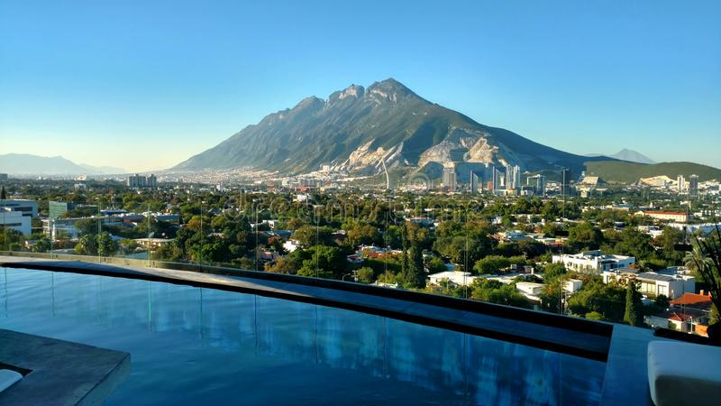 View of the Sierra Las Mitras. From an infinity pool in Monterrey, Mexico royalty free stock image