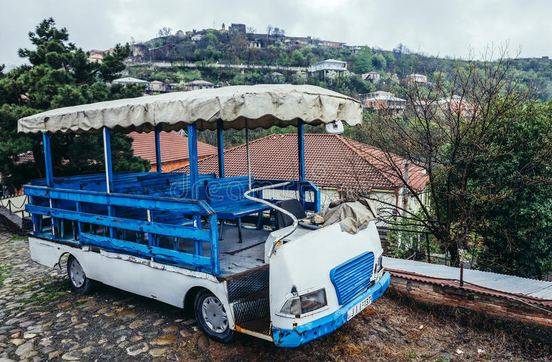 View in Sighnaghi. Sighnaghi, Georgia - April 24, 2015. Small tourist bus in Sighnaghi, small town in Kakheti district stock photo