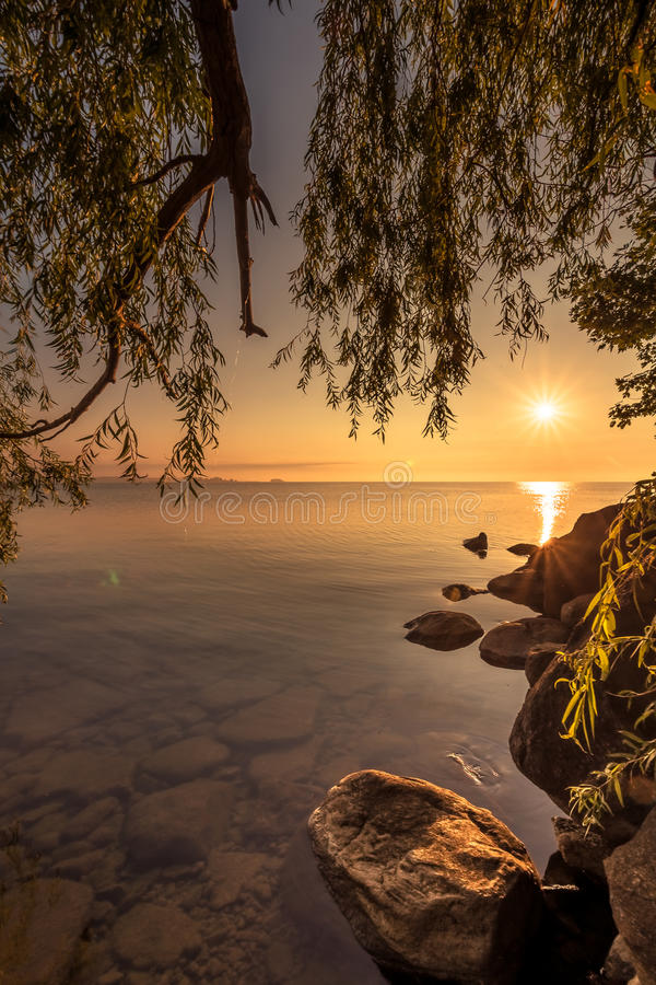 View of Simcoe lake during sunrise stock photo