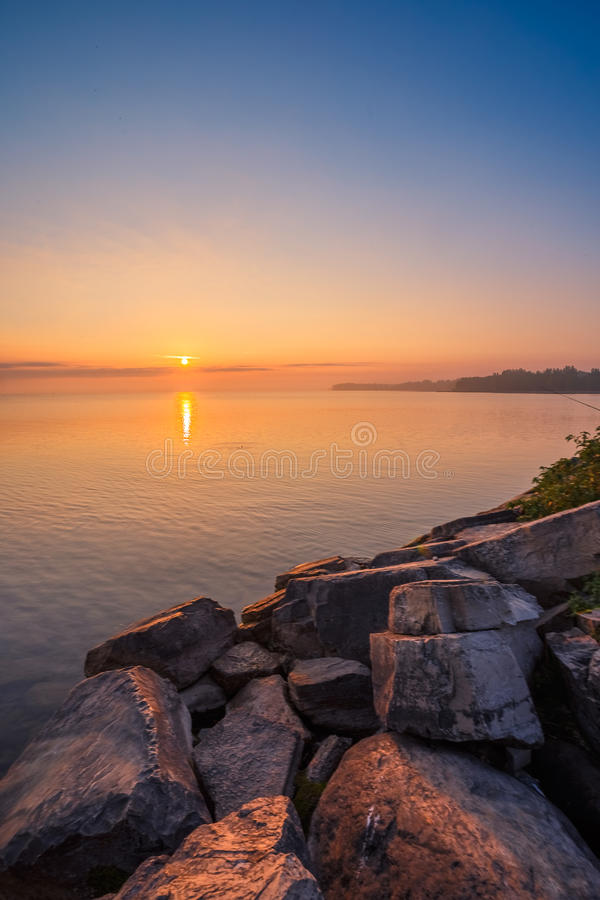 View of Simcoe lake during sunrise stock photography