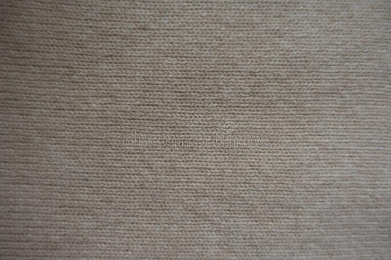 View of simple beige knitted fabric stock images