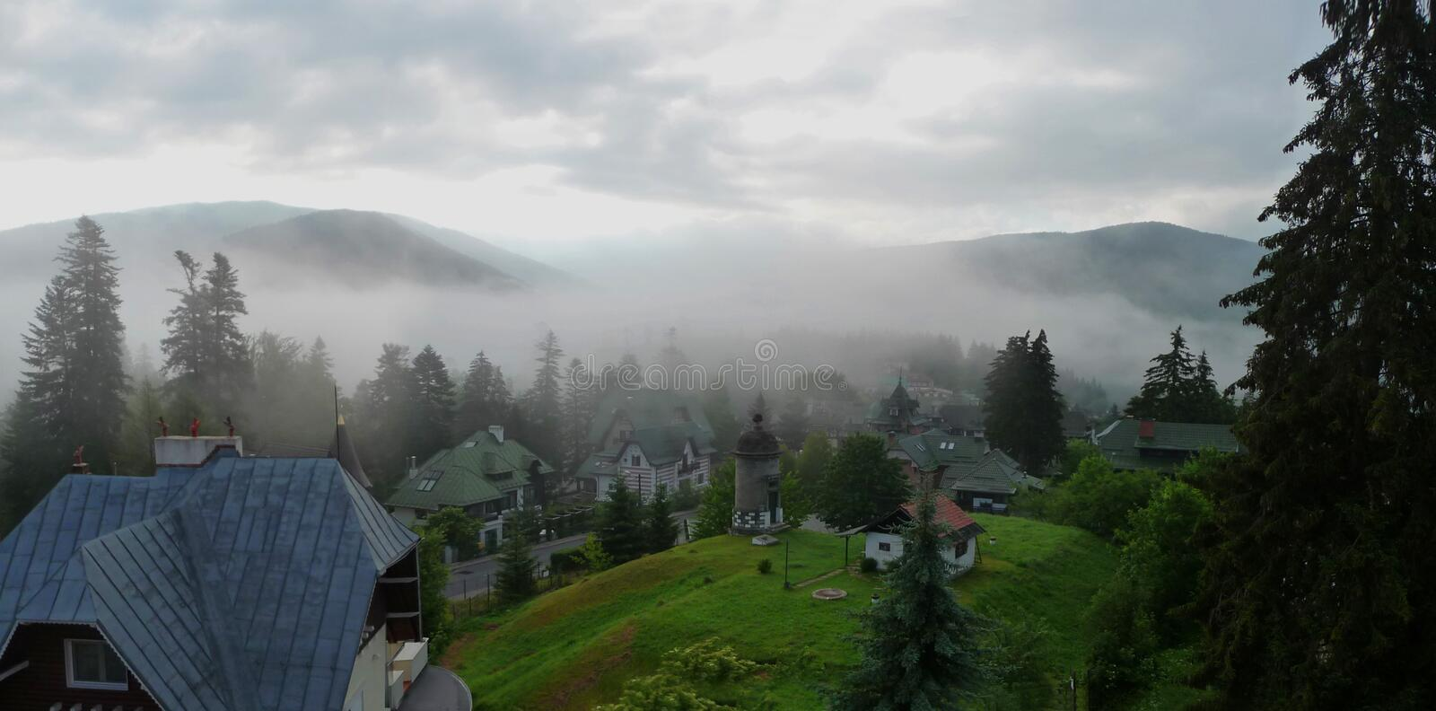 View of Sinaia. Romania. Foggy landscape with traditional houses and mountains in Sinaia. Romania royalty free stock photography