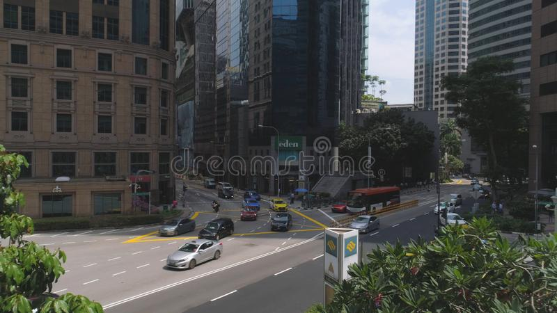 View of Singapore downtown streets with shops and heavy traffic. Shot. Traffic in the city during the day, movement of royalty free stock photos