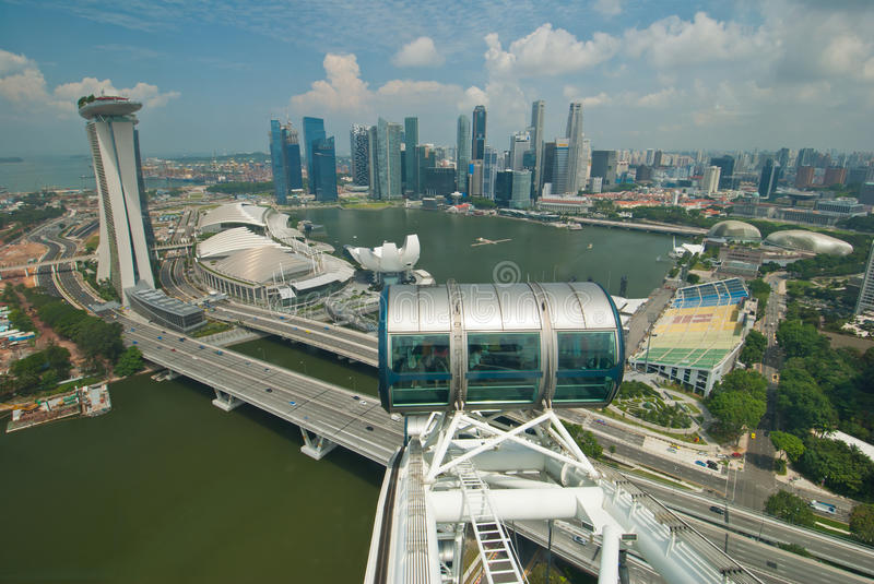 View from Singapore flyer. SINGAPORE - JUNE 12: Breathtaking view of the Singapore skyline from the Singapore flyer at Marina Bay, taken on June 12, 2011 in stock photos