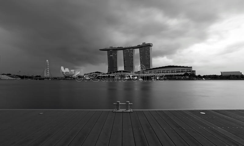 A view of the Singapore Marina Bay Signature Skyline in black and white photo across the deck royalty free stock photography