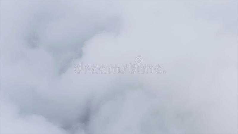 View of the sky above the clouds. Shot. Top view of clouds. Flying above the clouds. View from the airplane.  royalty free stock photography