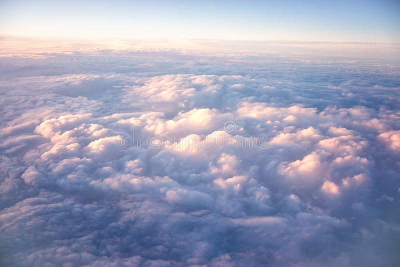 Flying above the clouds. View sky and clouds from an airplane. flying above the clouds stock image