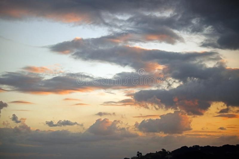 SOFT GLOW ON CLOUDS AT SUNSET royalty free stock images