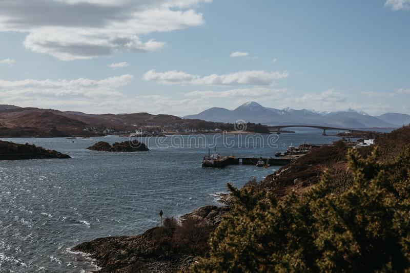 View of Skye Bridge and a small coastal village on Isle of Skye, Scotland, on a sunny day. View from Kyle of Lochalsh stock photography