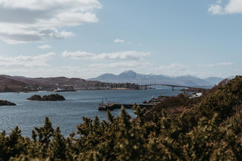 View of Skye Bridge and a small coastal village on Isle of Skye, Scotland, on a sunny day. View from Kyle of Lochalsh royalty free stock images