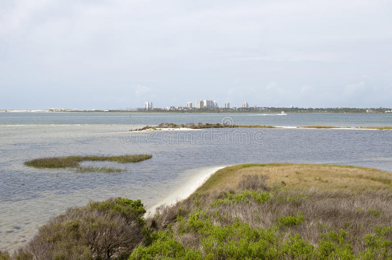 A view of the skyline of Perdido Key from the waters of Big Lagoon State Park in Pensacola, Florida. A view of Perdido Key from the waters of Big Lagoon in royalty free stock photography