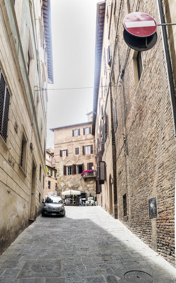 View of the small alley called `Via di Monna Agnese` between Piazza S. Giovanni and Poggio street stock images
