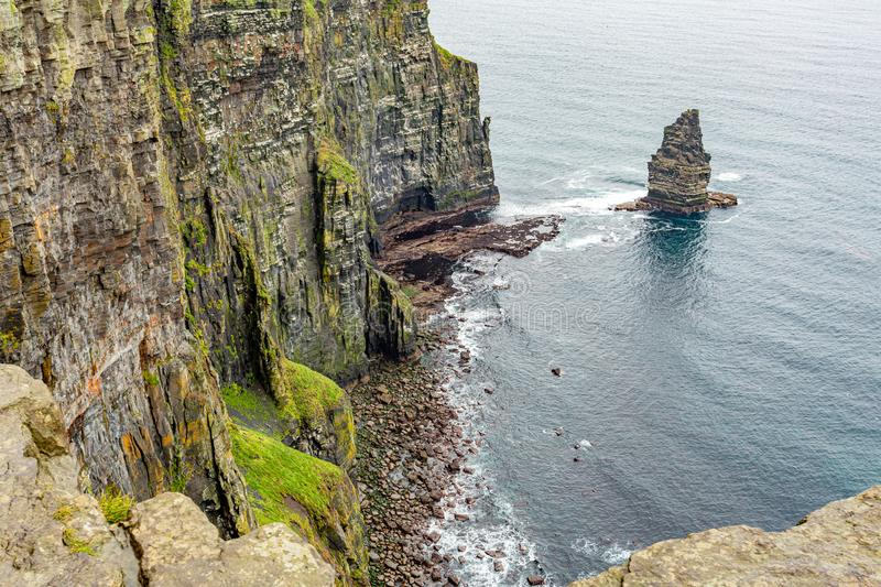 View of a small part of the coast of the Cliffs of Moher and the Branaunmore sea stack. Geosites and geopark, Wild Atlantic Way, wonderful cloudy spring day in stock image