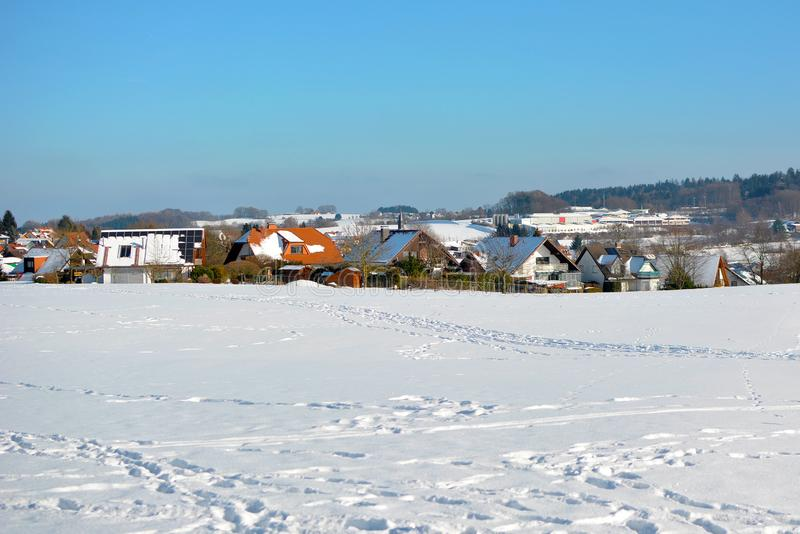 View of small rural town in Odenwald in Germany with clearing covered in snow during winter. In EUrope stock images