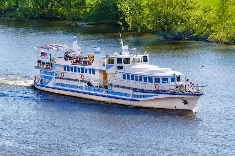 View on a small ship on the river. Aerial view on a small ship on the river a background of green trees on the shore stock photography