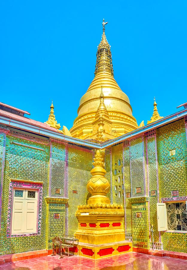 The main stupa of Su Taung Pyae Pagoda in Mandalay, Myanmar. The view on small stupa in inner courtyard and the main one, dominating over Su Taung Pyae Pagoda stock photography