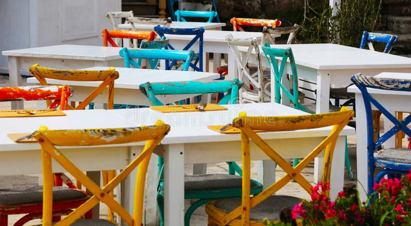 Coloured chairs in Marzamemi, Sicily. View of the small town of Marzamemi, detail of coloured chairs royalty free stock photo