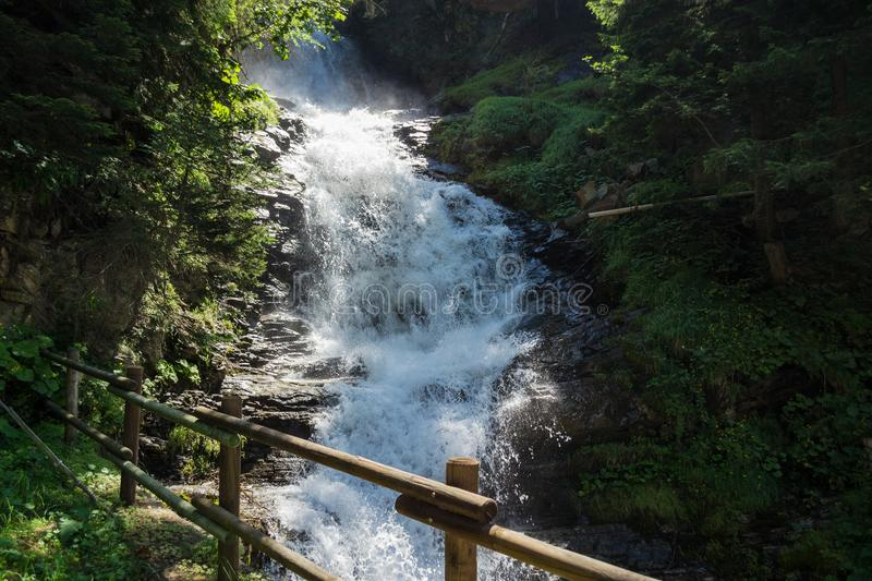 Small waterfall in the mountain royalty free stock photos