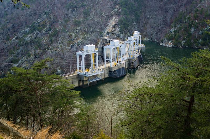 View of Smith Mountain Dam. Sandy Level, VA – January 8th:A view of the Smith Mountain Hydroelectric Dam from the walking trail located, in Bedford and royalty free stock photos