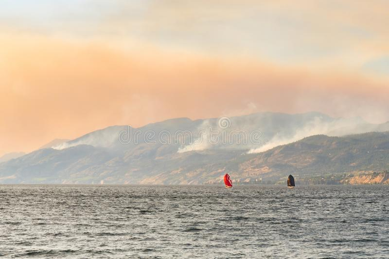 View of smoke from three forest fires in mountains. Three lightening caused forest fires in the mountains near the community of Naramata, British Columbia royalty free stock photography