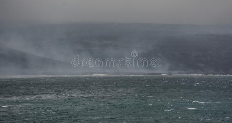 View of the smokey beach of Saunders Island, South Sandwich Islands - a remote island chain in the Atlantic Ocean stock photography