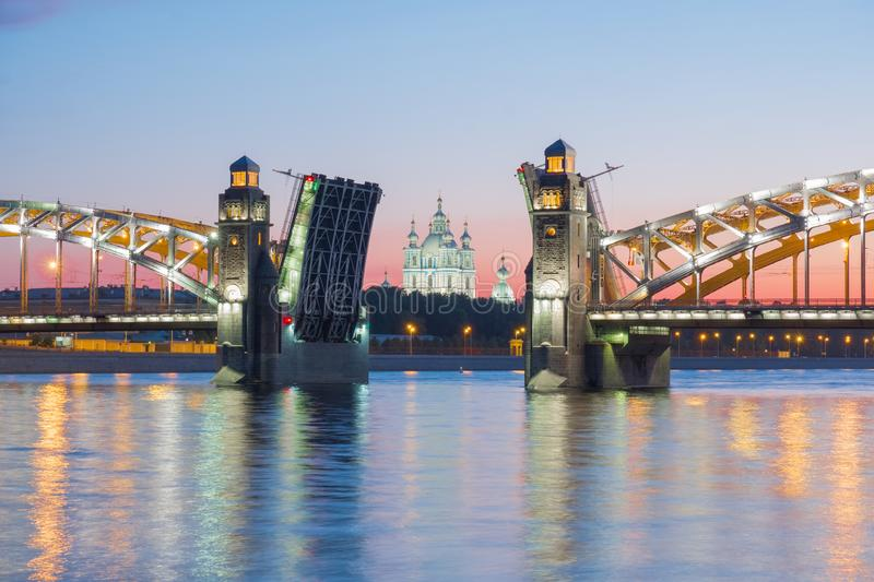 View of the Smolny Cathedral and the divorced Bolsheokhtinsky bridge during the white nights. St. Petersburg. Russia royalty free stock image
