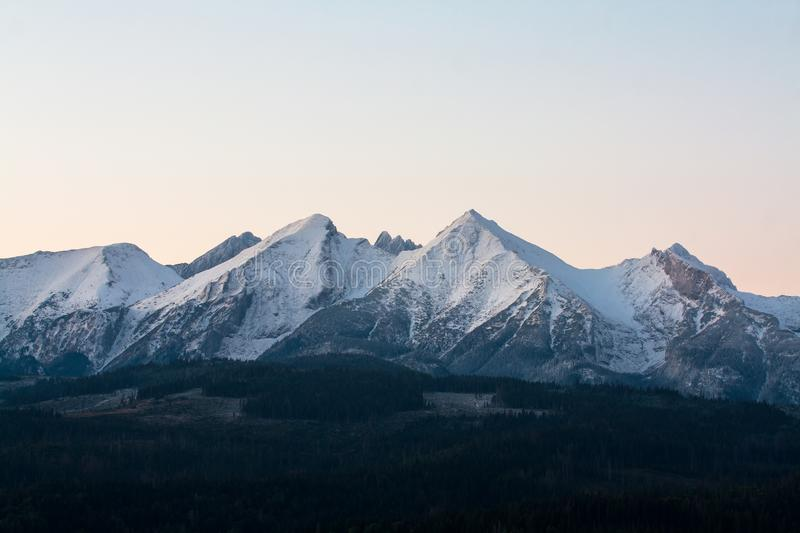 View of the Tatras from the village of Łapszanka. stock photography