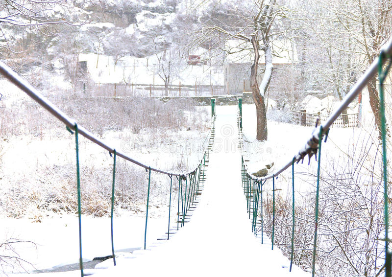 View of snow-covered bridge in the village. royalty free stock photo