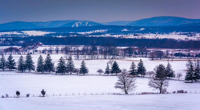 View of snow-covered farm fields and distant mountains from Long royalty free stock images
