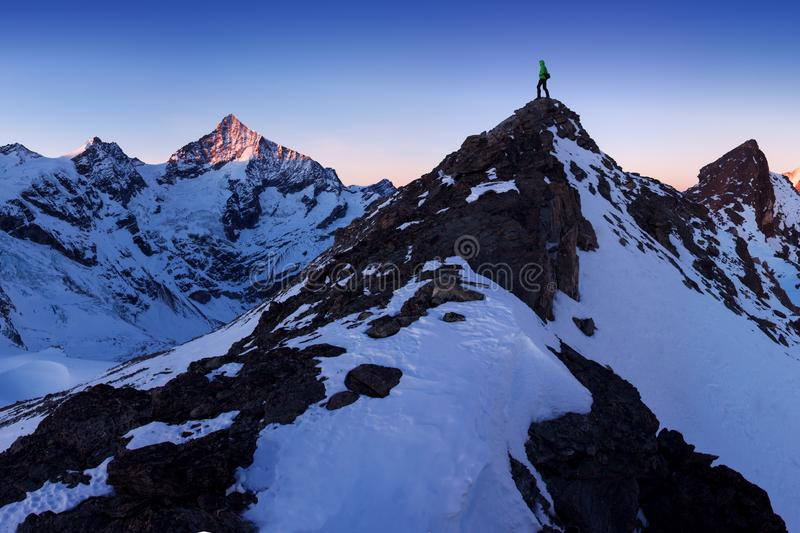 View of snow covered landscape with Weisshorn mountain in the Swiss Alps near Zermatt. Panorama of the Weisshorn and surrounding. Mountains in Switzerland above royalty free stock photography