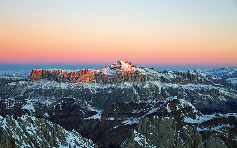 View of Snow Covered Mountain during Sunset royalty free stock photo