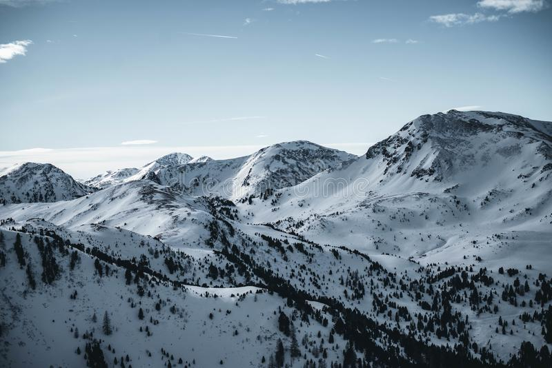 View of snow covered Nocky mountains in austrian Alps. Sunset over white peaks. royalty free stock image