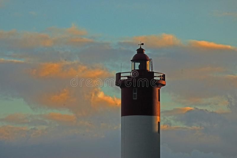 UMHLANGA ROCKS LIGHTHOUSE IN THE GLOW OF THE SETTING SUN stock photo