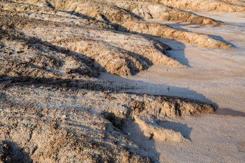 View of soil erosion near saline lake Baskunchak, Russia. Uneven ground near saline lake Baskunchak in Astrakhan region, Russia stock photos
